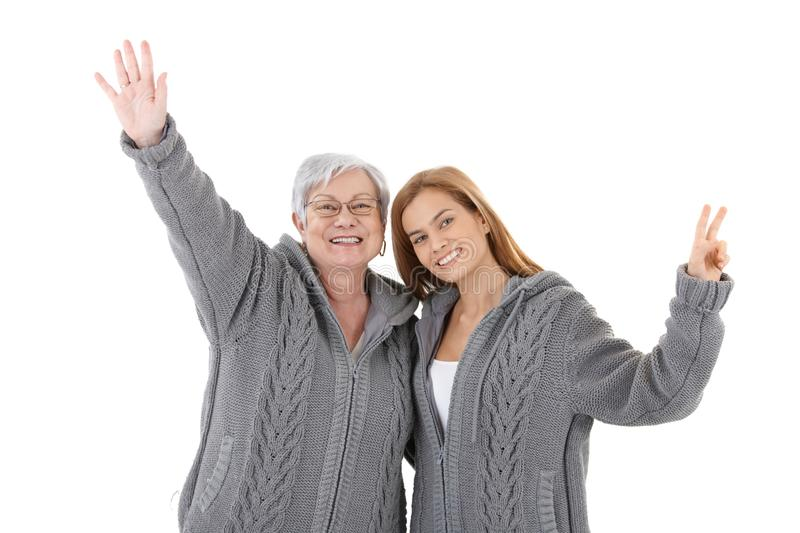 Mother and daughter posing and smiling stock image