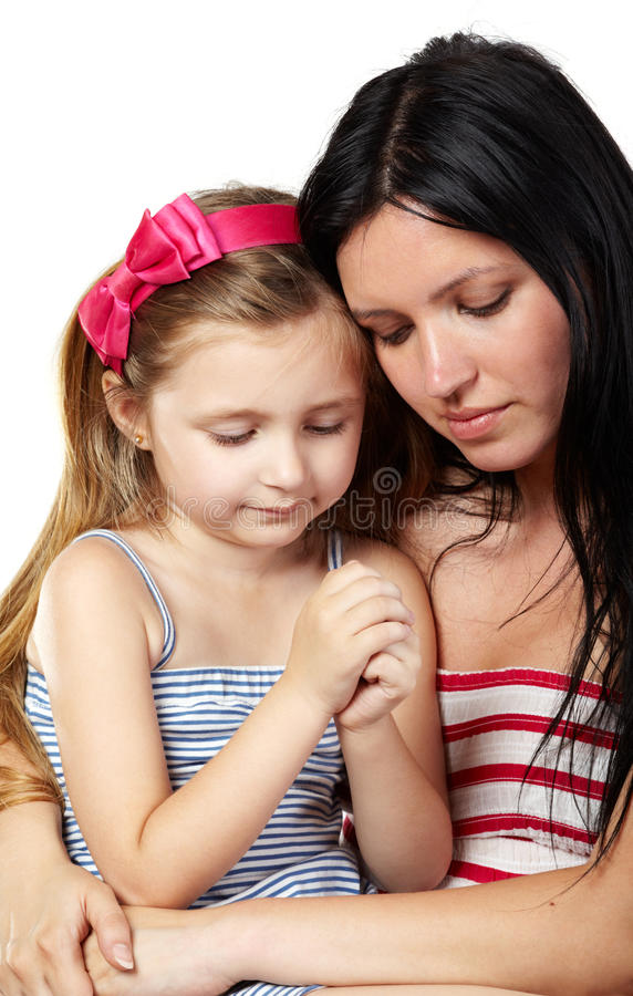 Mother and daughter pray stock images