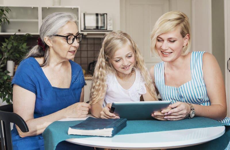 Mother, Daughter and Preschool Granddaughter Scrolling Web stock image