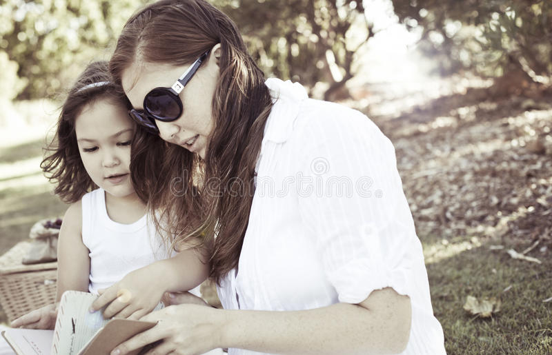 Mother and daughter reading royalty free stock photo
