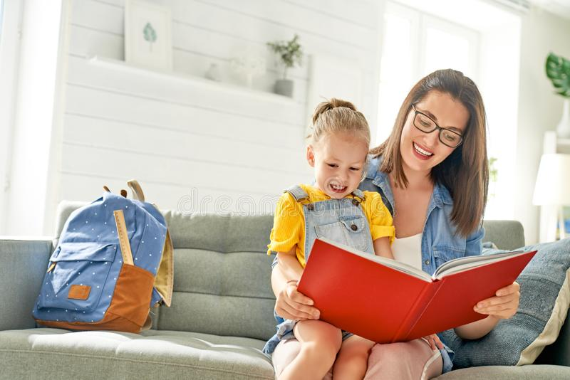 Mother and daughter are reading a book royalty free stock photo