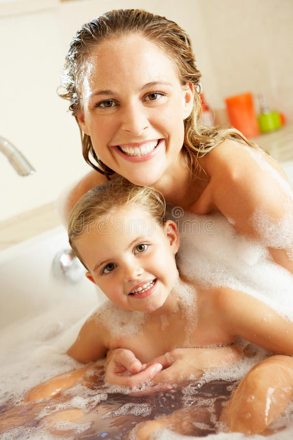Download Mother And Daughter Relaxing In Bubble Filled Bath Stock Photo - Image of bubbles, caucasian: 27271628