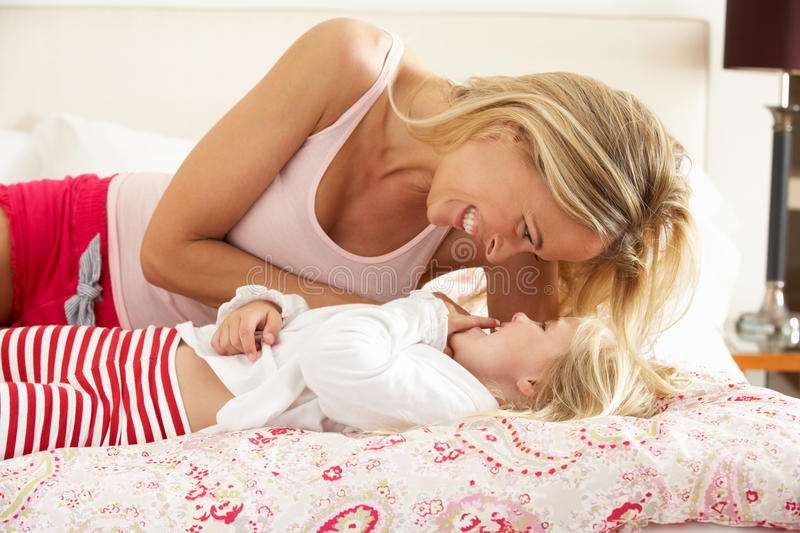 Download Mother And Daughter Relaxing Together In Bed Royalty Free Stock Image - Image: 26616046
