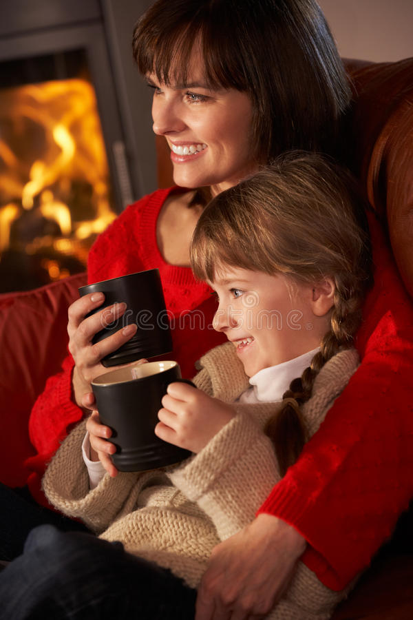 Mother And Daughter Relaxing Watching TV Royalty Free Stock Photo