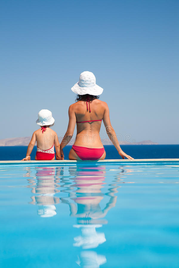 Mother with daughter on resort stock images