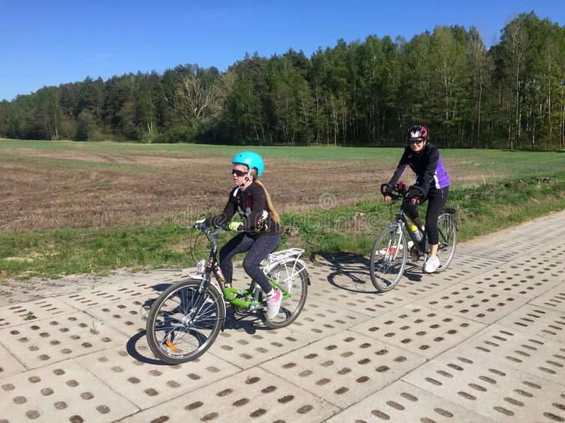Mother and daughter on bicycles stock photography