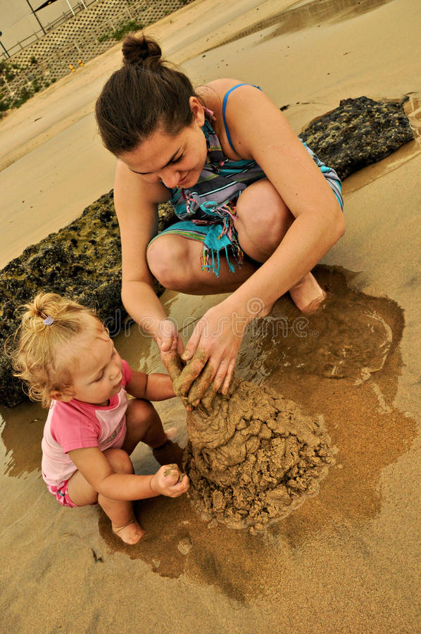Mother And Daughter Sand Castle stock photo