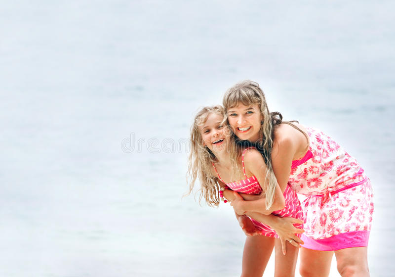 Download Mother And Daughter On Sea Background Stock Photo - Image of child, outside: 12877294