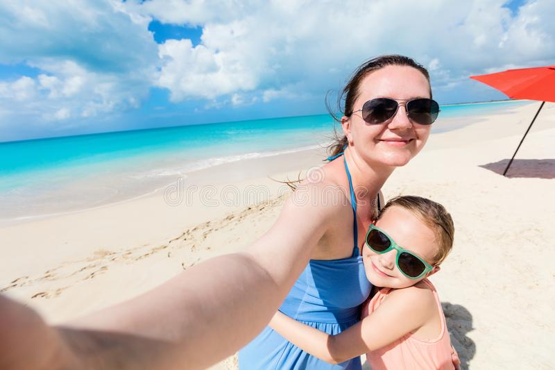 Mother and daughter selfie. Happy family mother and her adorable little daughter at beach taking selfie royalty free stock images
