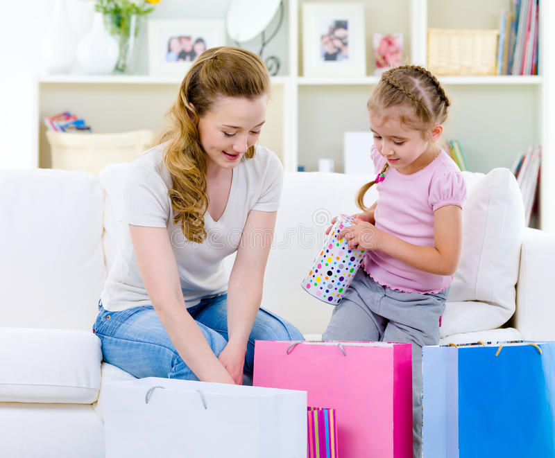 Mother with daughter after shopping royalty free stock photography