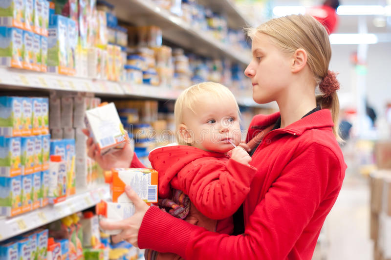 Mother with daughter shopping in supermarket stock images