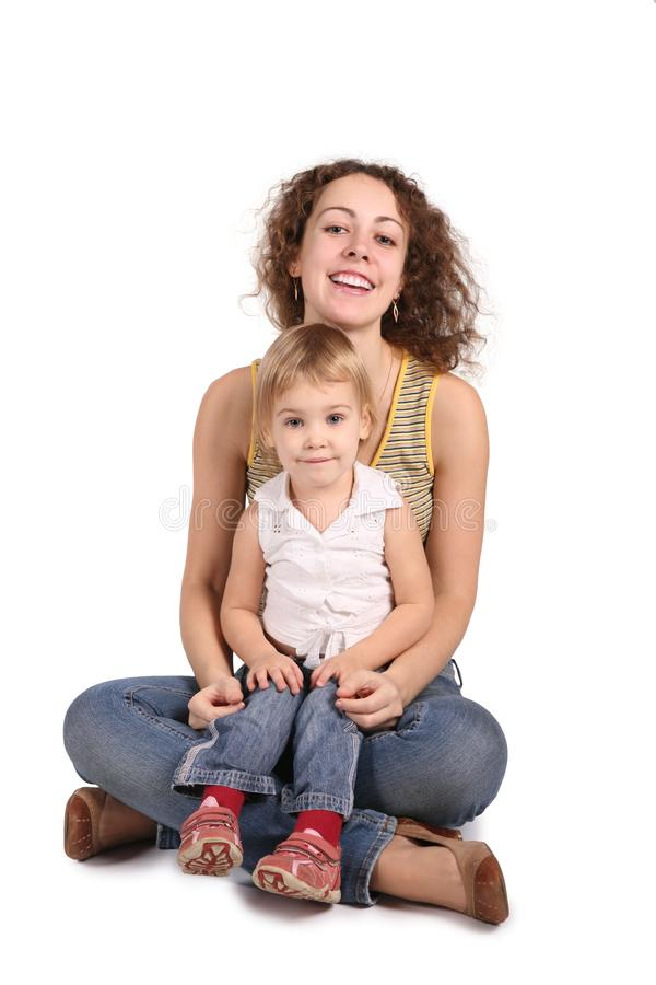 Mother and daughter sit royalty free stock photo