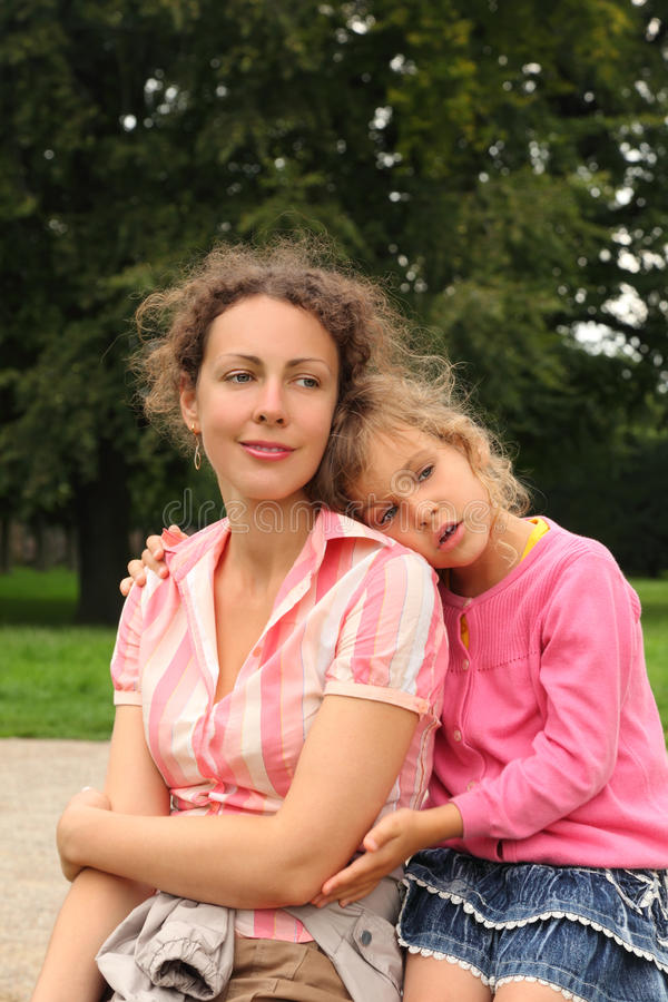 Download Mother And Daughter Sit In Park Stock Images - Image: 26337634