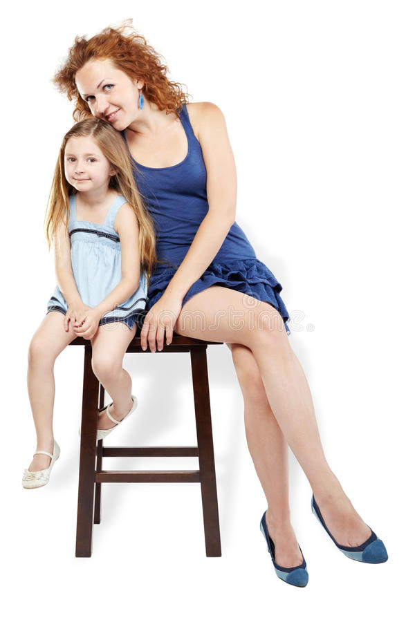 Download Mother And Daughter Sit On Stool Stock Image - Image: 26281891