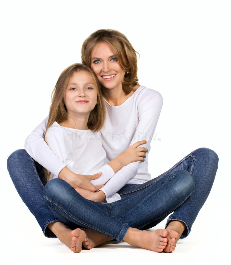 Mother and daughter sitting on the floor royalty free stock images