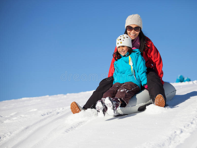 Mother And Daughter Sled Ride II. Mother and daughter happy expression enjoying a sled ride in St. Cergue, Switzerland stock photos