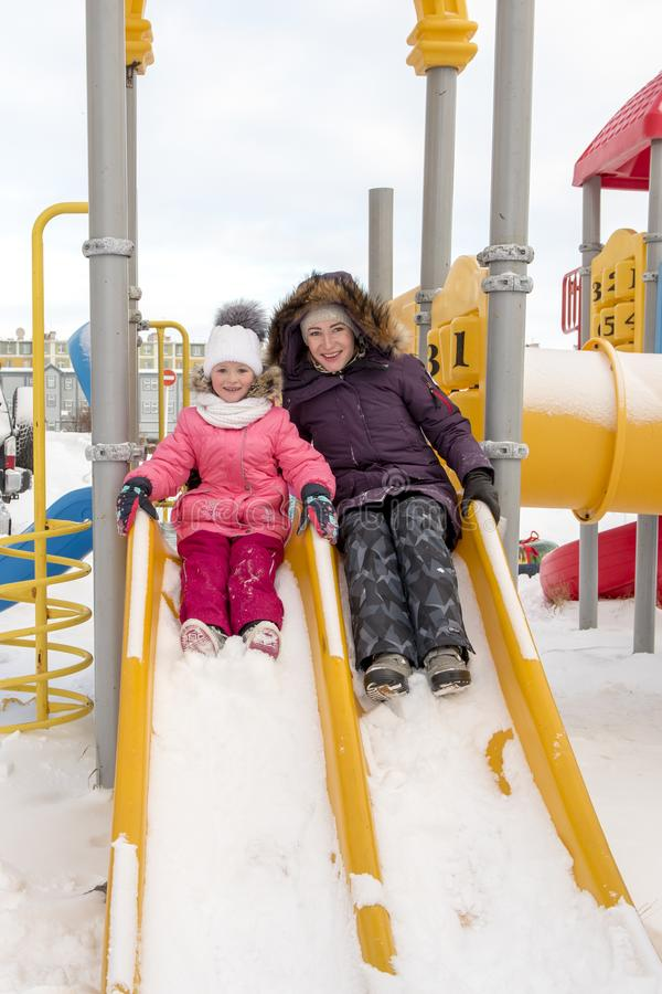 Mother and daughter on the slide royalty free stock photography