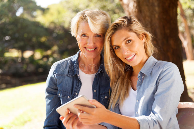 Mother daughter smart phone royalty free stock photography