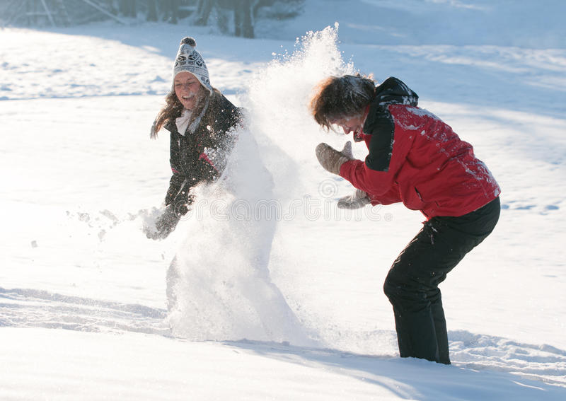 Mother And Daughter In Snow Stock Image