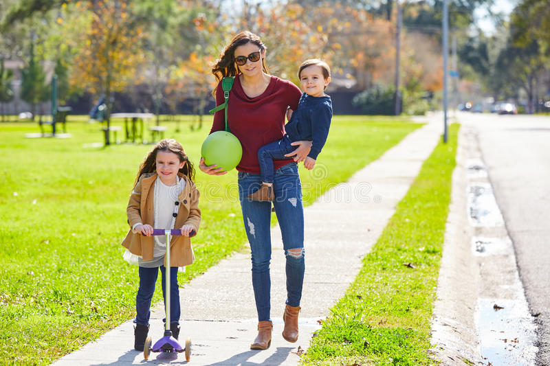 Mother daughter and son family in the park stock image