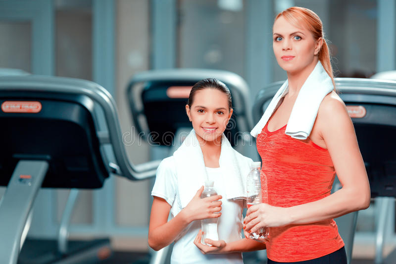 Mother and daughter at sports club stock photo