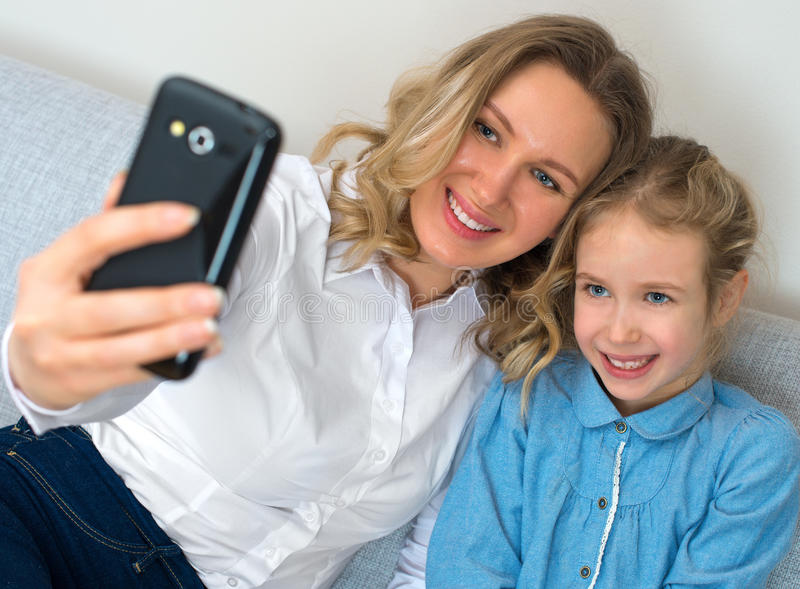 Mother and daughter taking selfie. royalty free stock images
