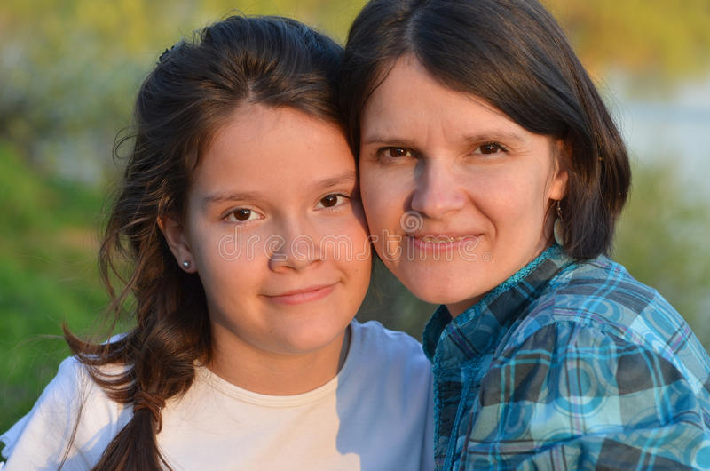Mother and daughter. Teenager girl and her mother royalty free stock image