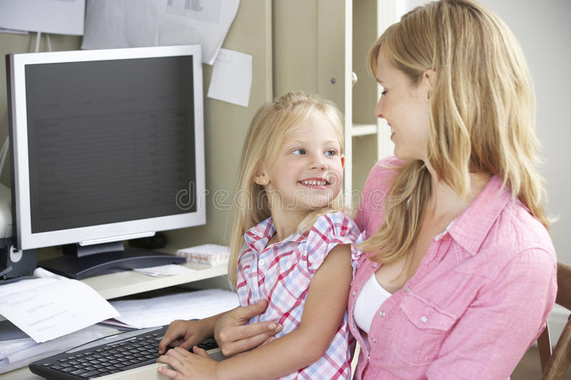 Mother And Daughter Together In Home Office royalty free stock photos