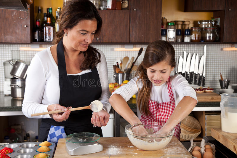 Download Mother And Daughter Together In Kitchen Stock Image - Image of bake, human: 23416393