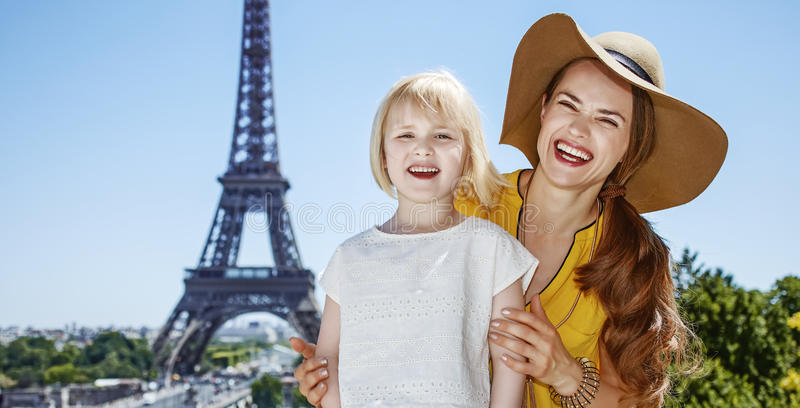 Mother and daughter tourists standing in front of Eiffel tower royalty free stock photography