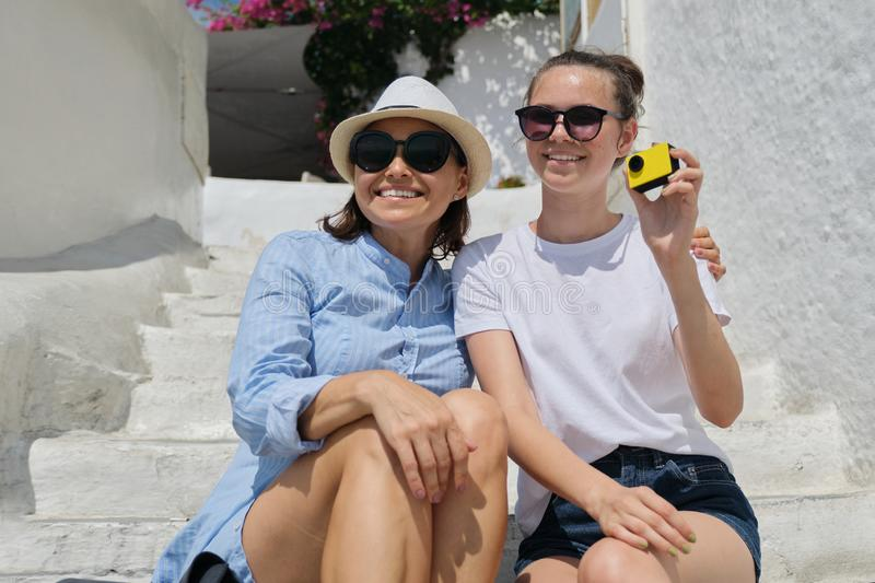 Mother and daughter traveling in Mediterranean recording blog on video royalty free stock photos