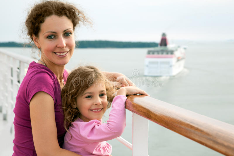 Mother and daughter traveling on ship royalty free stock photo