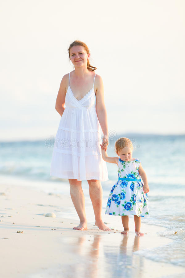 Download Mother And Daughter On Tropical Beach At Sunset Stock Image - Image: 15596023