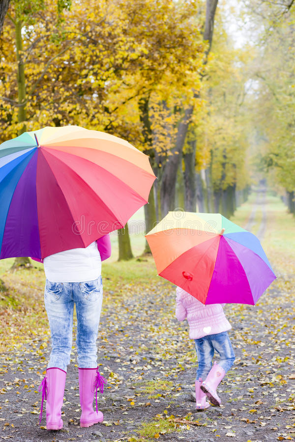 Mother And Daughter With Umbrellas Royalty Free Stock Image