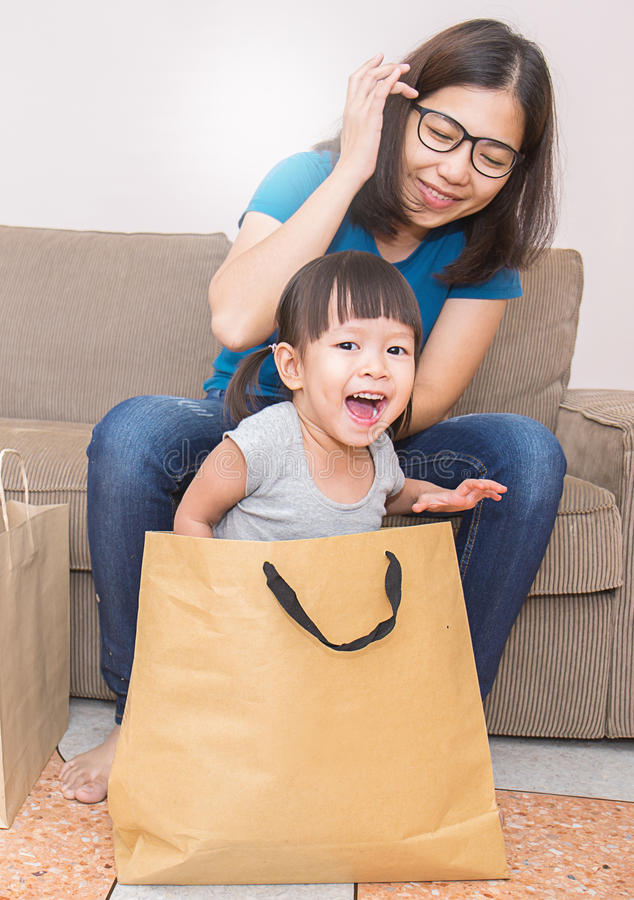 Mother and daughter unpacking shopping bags royalty free stock photos