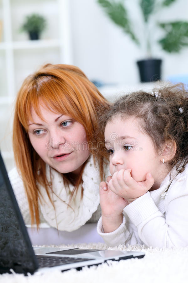Download Mother And  Daughter  Using Laptop Stock Illustration - Image: 26729676