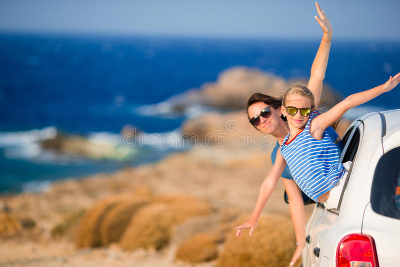Mother and daughter on vacation travel by car. Summer holiday and car travel concept. Family travel. stock photos