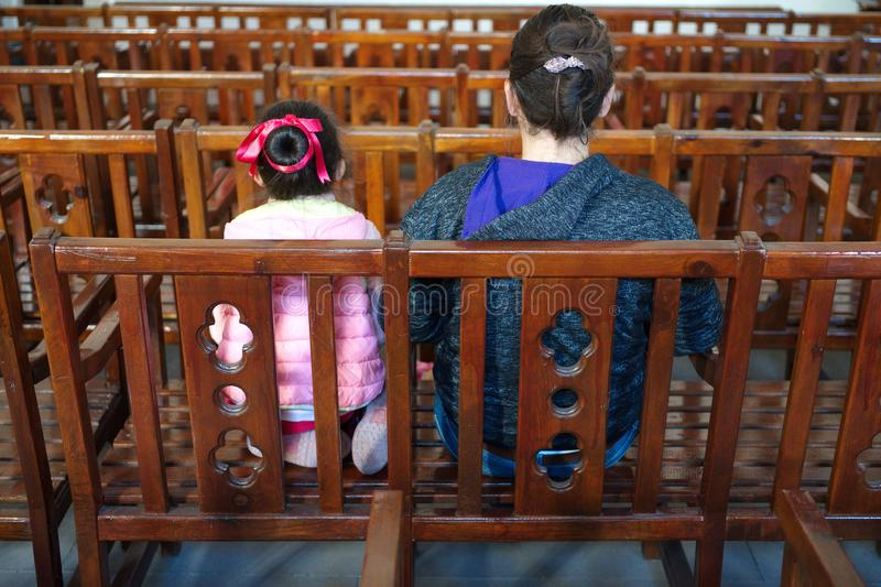 Mother and daughter. Waiting in assembly hall, activity, auditorium, business, meeting, chair, chat, collection, commercial, conference, congress, convention royalty free stock photos