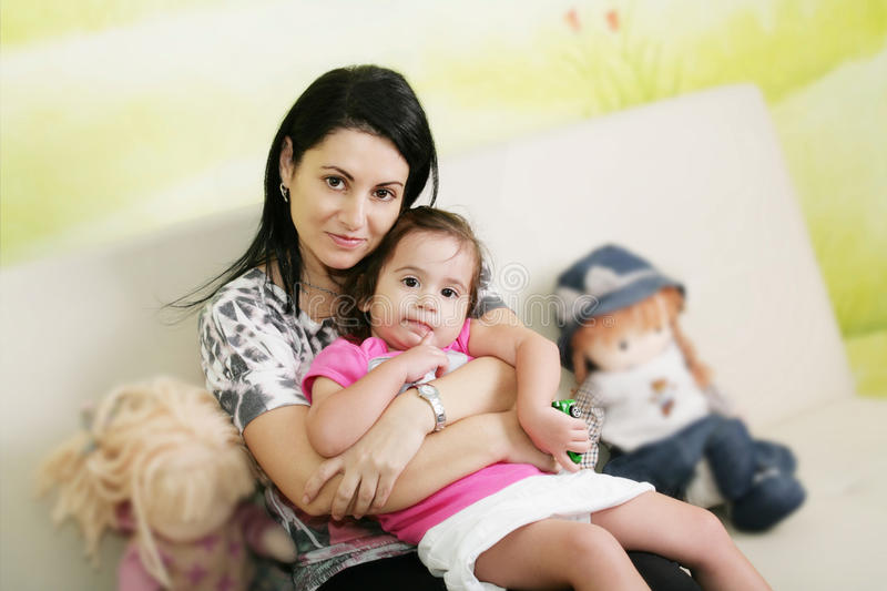 Mother and daughter waiting at doctors office. stock photos