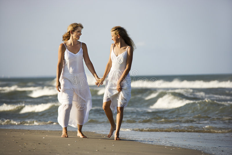 Mother and daughter walking stock image
