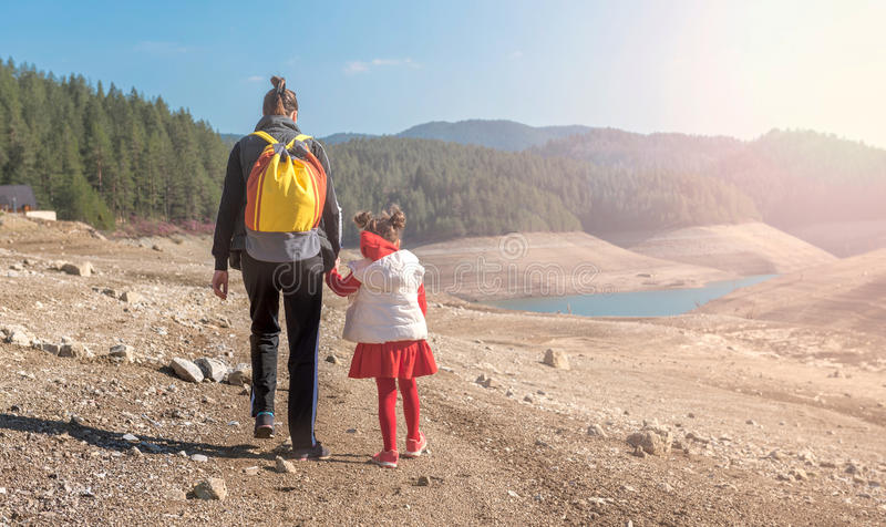 Mother and daughter walking. In the nature royalty free stock photo