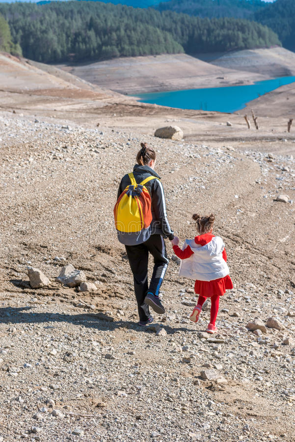 Mother and daughter walking outdoor. In the nature royalty free stock photo