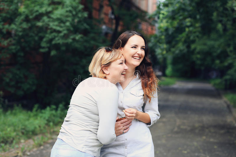 Mother and daughter are walking in the park. royalty free stock photo