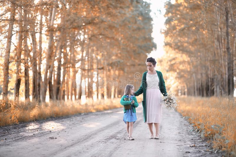 Mother with daughter walking on a road royalty free stock photo