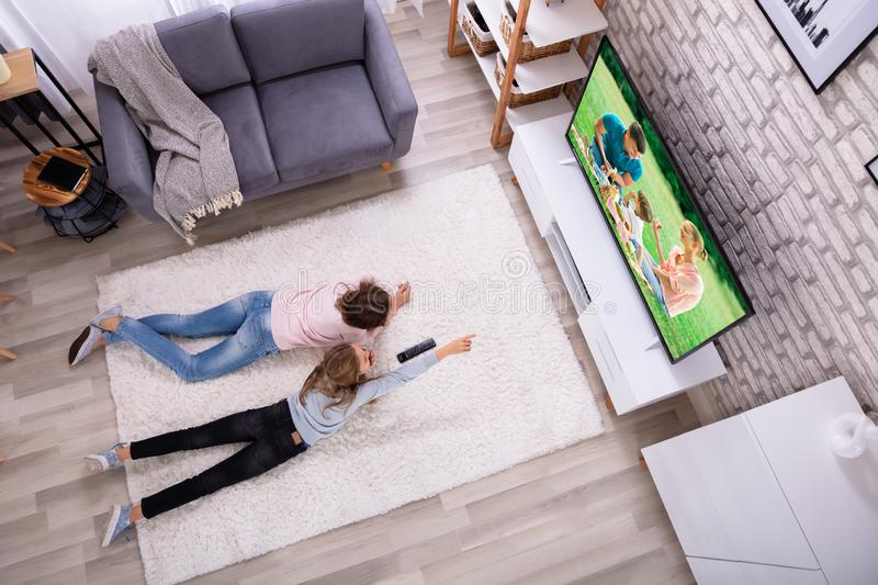 Mother And Daughter Watching Television stock image