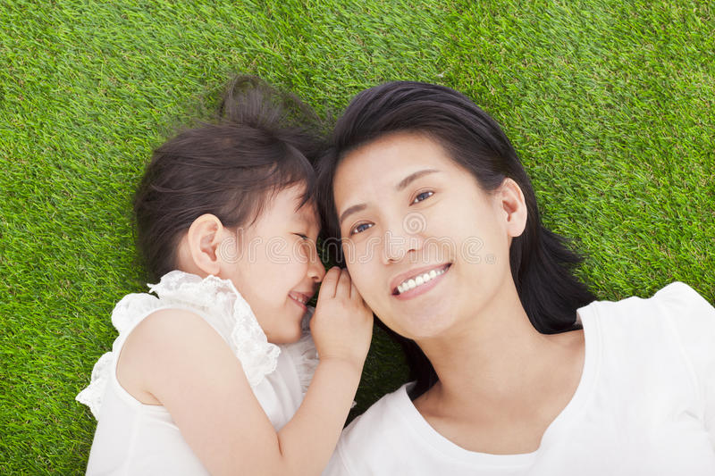 Download Mother And Daughter Whispering Gossip On The Grass Stock Image - Image: 40257055