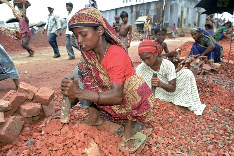 Mother and daughter working as stone breakers. Bangladesh, capital, city Dhaka, slum Pagla: portrait of Bengali women and girl working as stone breaker in a royalty free stock photos