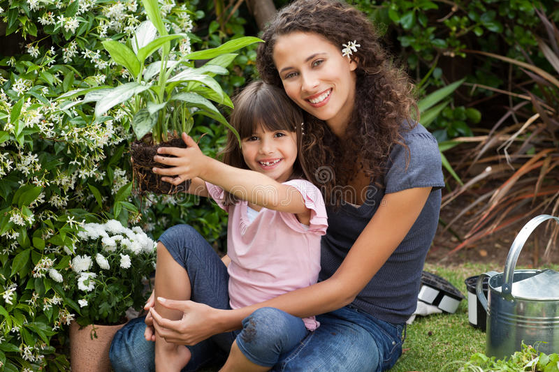 Mother and daughter working together royalty free stock photography