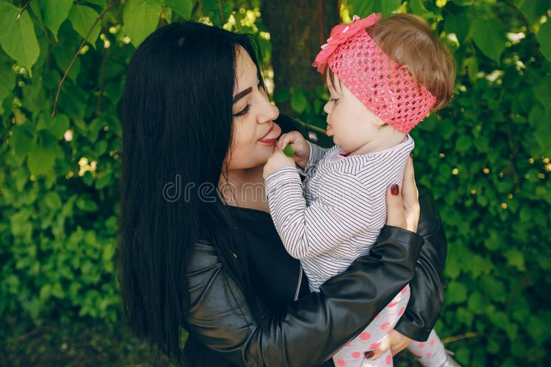 Mother with daughter. Young and beautiful mother with a child in the summer park stock photography