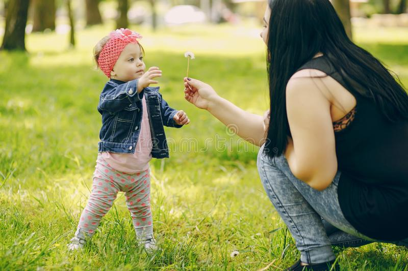 Mother with daughter. Young and beautiful mother with a child in the summer park stock images